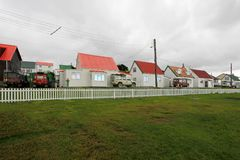 Brithis cars in front of typical british town houses in Port Stanley, Falkland Islands. Islas Malvinas Royalty Free Stock Images