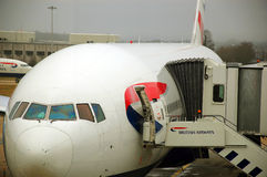 Brithish Airways aircraft. British Airways' Boeng 777 prepared for transatlantic flight at Gatwick airport Stock Image