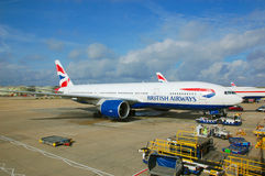 Brithish Airways aircraft. British Airways' Boeng 777 prepared for transatlantic flight at Gatwick airport Royalty Free Stock Images