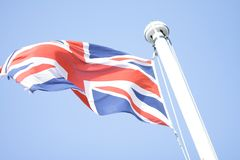Brithish flag in the blue sky stock photo