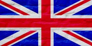BRITISCHE Flagge über Backsteinmauer stockfotografie