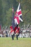 Britische Flagge und britische Truppen am Auslieferungs-Feld am 225. Jahrestag des Sieges bei Yorktown, eine Wiederinkraftsetzung Stockbilder