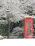 Britische rote Telefonzelle im Schnee Stockfoto