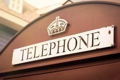 Britische Telefonzelle, Weinlesefarbe Stockfotos