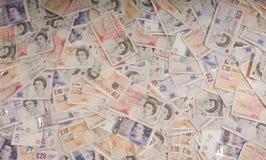BRITISCHER Sterling-Hintergrund Stockbilder