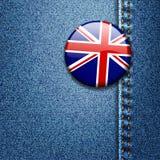BRITISCHES britisches Markierungsfahnen-Abzeichen auf Denim-Gewebe-Beschaffenheit Lizenzfreie Stockfotografie