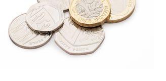 Britisches Geld, einschließlich neue Designpfundmünze Stockfotos