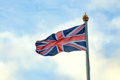 Britisches Union Jack-Fliegen Stockfotos