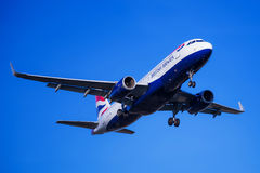 British Airlines plane landing. Photograph of a plane landing in El Prat airport, Barcelona, Spain Stock Images