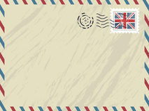 British airmail envelope. Envelope with airmail stripes, post mark and untied kingdom stamp Stock Photography