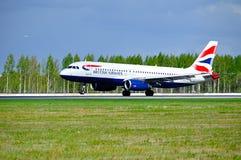 British Airways Airbus A320 aircraft is landing in Pulkovo International airport in Saint-Petersburg, Russia Stock Photos