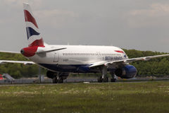 British Airways Airbus A320-232 aircraft landing on the runway Royalty Free Stock Photography