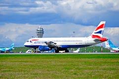 British Airways Airbus A320 airplane is landing in Pulkovo International airport in Saint-Petersburg, Russia Stock Images