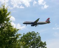 British Airways Airbus A320 on Approach to Heathrow Airport royalty free stock photo