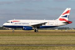 British Airways Airbus A319-100. With registration G-DBCG on take off roll on runway 36L Polderbaan of Amsterdam Airport Schiphol stock photo