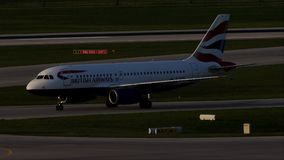 British Airways Airbus taxiing in Munich Airport, spring. British Airways jet doing taxi in Munich Airport, Munchen Flughafen stock video footage