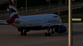 British Airways Airbus taxiing in Munich Airport, spring. British Airways jet doing taxi in Munich Airport, Munchen Flughafen stock footage