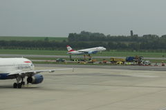 British Airways aircraft on the runway and Austrian Airlines air Stock Images