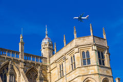 British Airways airplane flying above Windsor Castle Royalty Free Stock Images