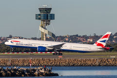 British Airways Boeing 777-300 aircraft taking off from Sydney Airport. stock image