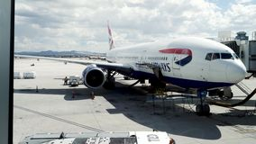 British Airways Boeing 777 being loaded and prepared by Las Vegas ground grew before flight to London stock video