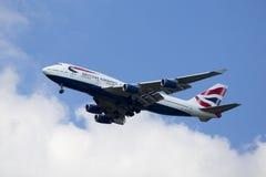 British Airways Boeing 747 descending for landing at JFK International Airport in New York. NEW YORK - AUGUST 13, 2015: British Airways Boeing 747 descending for Royalty Free Stock Photography