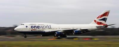 British airways Boeing747 jet on runway. British Airways and One World Boeing 747 jumbo jet in motion on the runway Stock Photography