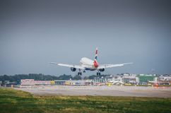 British Airways commercial airplane lands at Milan`s Linate airport. Linate is a main hub for Alitalia servicing many short and m. Milan, Italy. 10th July, 2017 Stock Photo