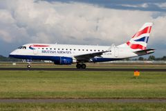 British Airways Embraer 170 G-LCYH passenger plane departure at Amsterdam Schipol Airport royalty free stock photography