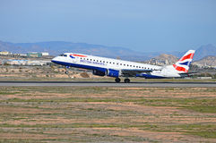 British Airways. The British Airways flight from London Heathrow touching down at Alicante airport stock images