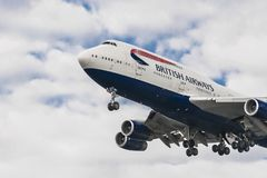 British Airways 747 landing. LONDON, UK - AUGUST, 6 2013; A British Airways Airbus Boeing 747 landing at London Heathrow Airport Royalty Free Stock Photography