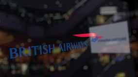 British Airways logo on the glass against blurred business center. Editorial 3D rendering Royalty Free Stock Photography