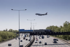 British Airways plane crossing M25 before landing stock photo