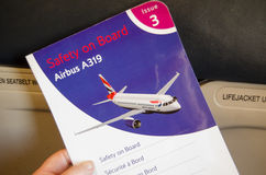 British Airways Safety Card. LONDON, ENGLAND - JUNE 14:  British Airways passenger safety card on board an Airbus A319, Economy section on June 14 2013.  A Stock Photo