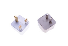 British and American plug adaptors isolated. On white background Stock Images