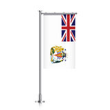 British Antarctic Territory flag. British Antarctic Territory vector banner flag hanging on a silver metallic pole. Vertical British Antarctic Territory flag Stock Image