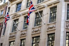 British architecture decorated with Union Jack flags. Ornate British facade decorated with the flag of the United Kingdom or Union Jack flags Royalty Free Stock Photo
