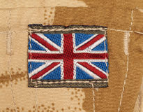 British Army Badge on Desert Camouflage Stock Photography