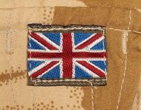 British Army Badge on Desert Camouflage stock photography