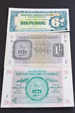 British Army North African Notes. Bank notes used by the British Army overseas. Sixpence dates from 1950 and the others from the North African campaign 1943 Royalty Free Stock Image