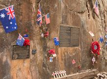 Flags and memorials at Hellfire Pass on the notorious Burma to Thailand death railway. British, Australian, and US flags at the memorial at Hellfire Pass on the Stock Photos