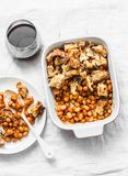 British baked tomato sauce bean and bacon with bread crumbs and glass of red vine on light background, top view. Stock Images
