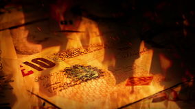 British Banknotes Rotating In Fire stock footage
