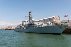 British battleship in harbor Stock Photos