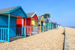 British beach huts. Brightly coloured british beach huts on calshot beach .south Coast Royalty Free Stock Images