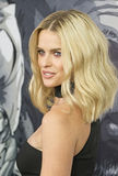 British blond bombshell Alice Eve. Steamy British actress Alice Eve arrives on the red carpet for the New York City premiere of a suspense thriller, Criminal, at Stock Photos