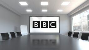 British Broadcasting Corporation BBC logo on the screen in a meeting room. Editorial 3D animation. British Broadcasting Corporation BBC logo on the screen in a stock illustration