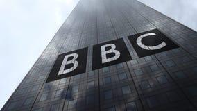 British Broadcasting Corporation BBC logo on a skyscraper facade reflecting clouds, time lapse. Editorial 3D rendering. British Broadcasting Corporation BBC logo stock illustration