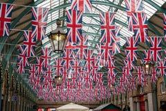 British bunting. British Union jack flag bunting hanging in large public space Royalty Free Stock Image