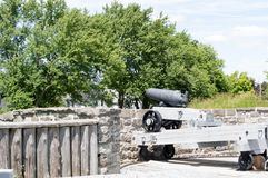 British Carronade on a Seacoast Mount. A British smooth bore iron cannon manufactured in the nineteenth century.  It is currently located in Fort Wellington Royalty Free Stock Image